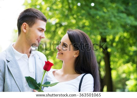 Boyfriend and girlfriend being happy in the park. - stock photo