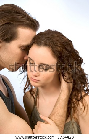boyfriend comforts young female in tears - stock photo