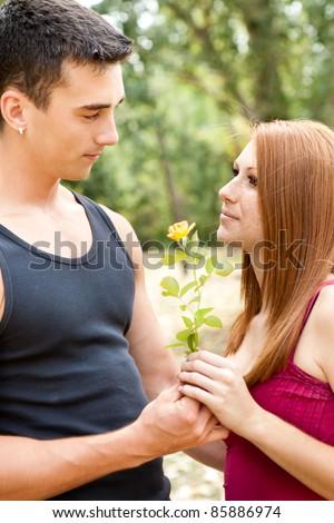 boyfriend giving flower his girlfriend - stock photo