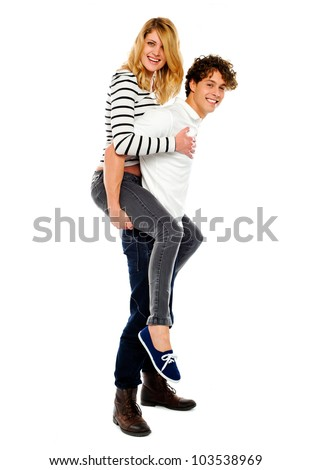 Boyfriend giving piggy ride to his girl isolated on white background