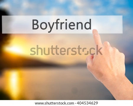 Boyfriend - Hand pressing a button on blurred background concept . Business, technology, internet concept. Stock Photo