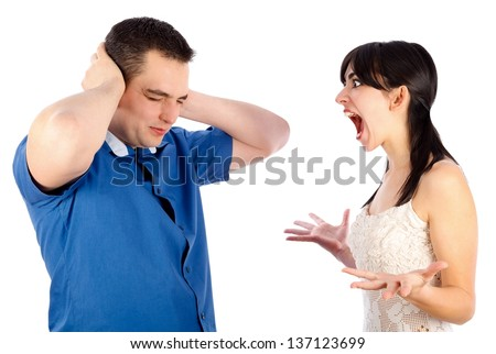 Boyfriend neglecting his extremely hysteric girlfriend. - stock photo