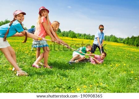 Boys against girls - stock photo
