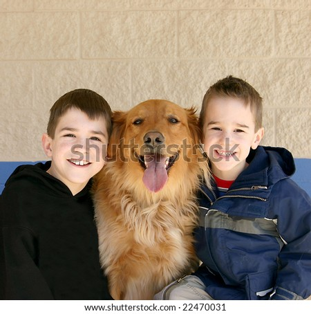 Boys and Golden Retriever - stock photo