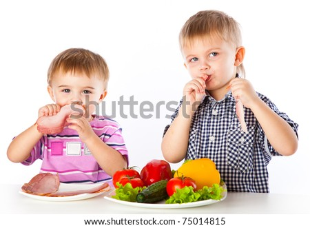 Boys and plates of vegetables and meat. Isolated on a white background - stock photo