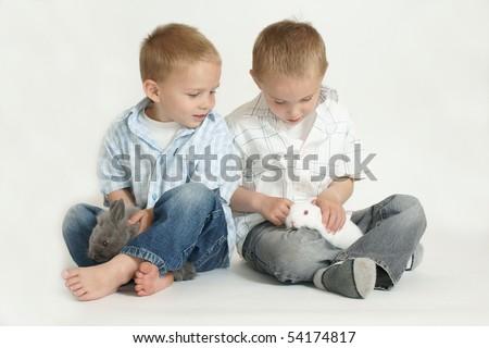 boys and rabbits - stock photo