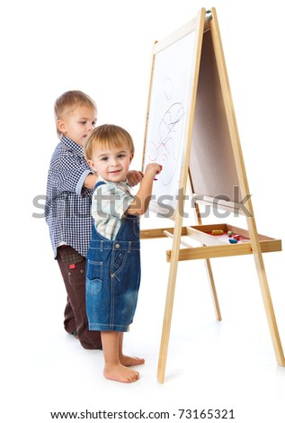 Boys are drawing on a blackboard. Isolated on a white background - stock photo