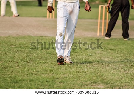 Boys are playing cricket at Maidan in Calcutta, India