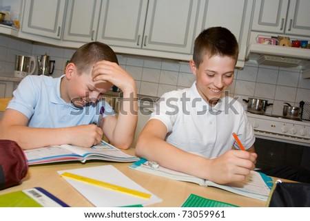 Boys doing homework - stock photo