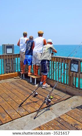 Boys Fishing From Pier - stock photo