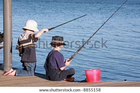 Boys Fishing off the Pier - stock photo