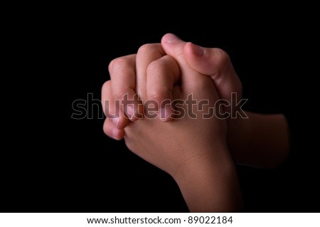 Boys Folded hands praying - stock photo