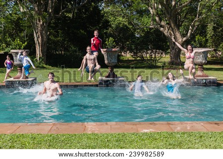 Boys Girls Jumping Swim Pool Teenagers boys girls running jumping into swimming home summer playtime - stock photo