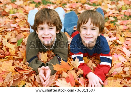 Boys Having Fun in the Leaves