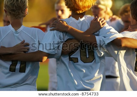 Boys high school soccer huddle - stock photo