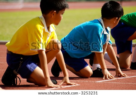 Boys is prepare to start running in highschool sport event. - stock photo