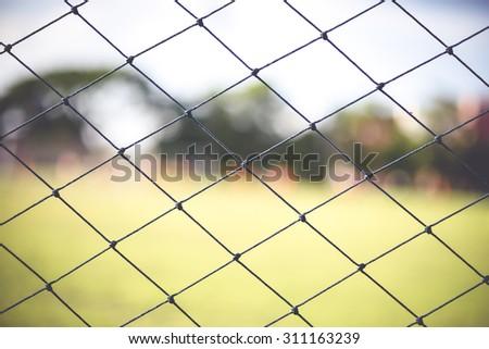 boys kicking football on the sports field,abstract blur - stock photo