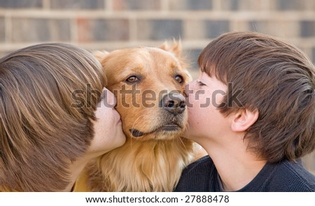 Boys Kissing Dog - stock photo