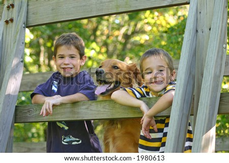 Boys on Bridge with Dog - stock photo