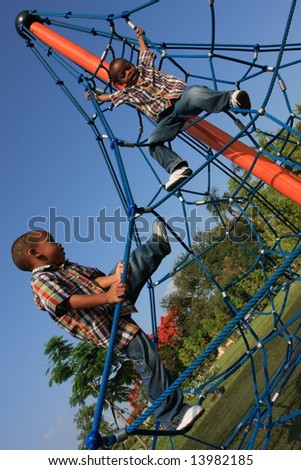 Boys on Ropes - stock photo