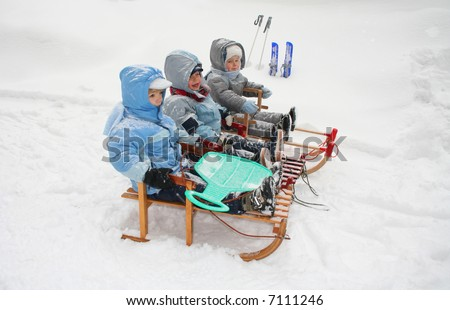 BOYS ON SLED - stock photo