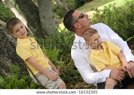 boys on the swing with dad - stock photo