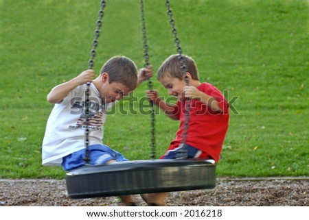 Boys on Tire Swing with motion blur - stock photo