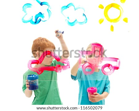 Boys painting art pictures on glass. Isolated on white.
