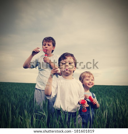 boys play in  bubbles - stock photo