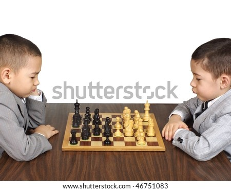 Boys playing chess - stock photo