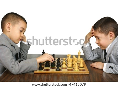 Boys playing chess, six and eight years old, isolated on white background