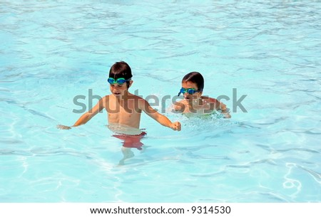 Boys Playing in the Pool - stock photo