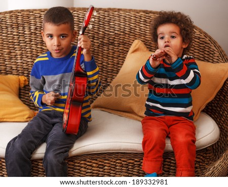 Boys playing musical instruments - stock photo