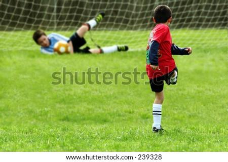 Boys Playing Soccer - stock photo