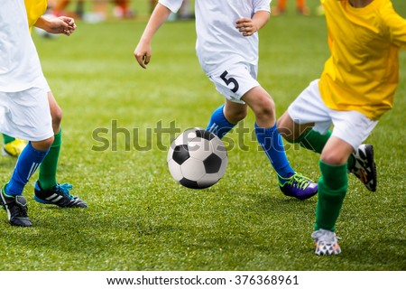 Boys Playing Soccer Game - stock photo