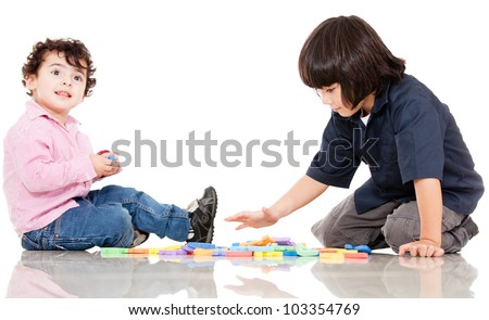 Boys playing with letters - isolated over a white background