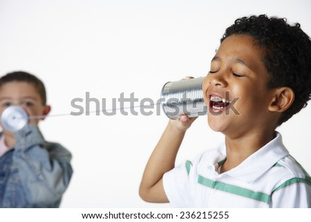 Boys Playing with Tin Can Phone - stock photo