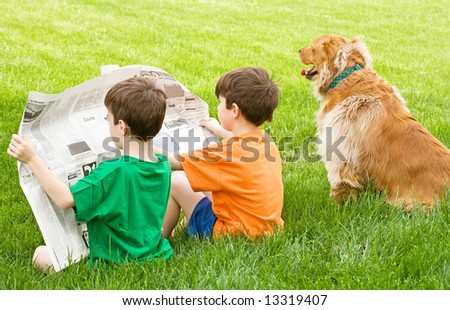 Boys Reading the Newspaper - stock photo