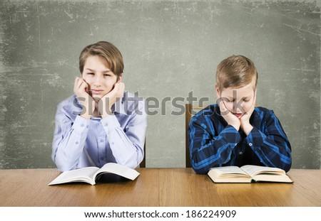 Boys reads books - stock photo