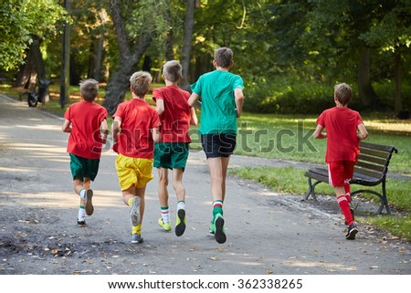 Boys running in park - stock photo