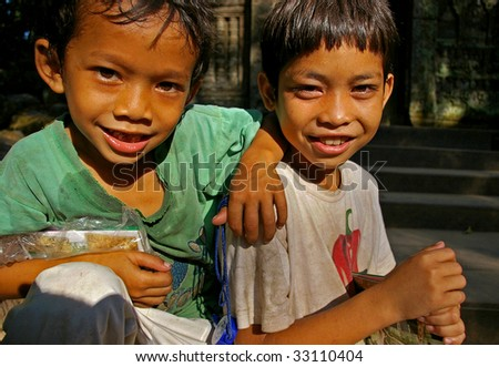 Boys selling postcards at Bayon Temple, Siem Reap, Cambodia. - stock photo