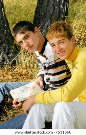 boys sitting with a book - stock photo