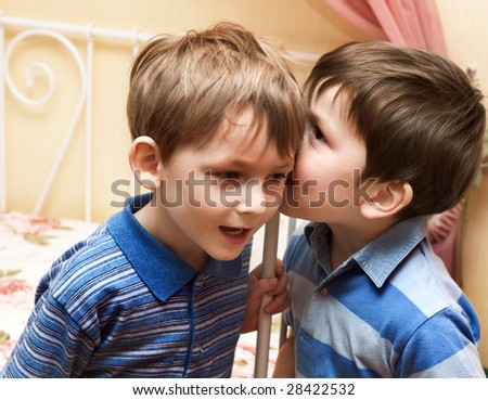 Boys telling secrets - stock photo