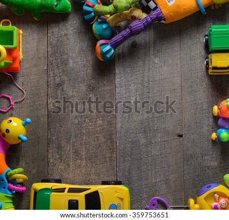 boys toys, frame made of accessories for children on old table.  top view. copy space. - stock photo