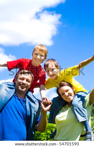 boys with family in the summer park - stock photo