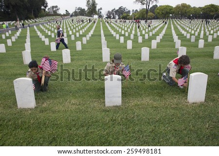 Boyscouts placing one of 85, 000 US Flags at 2014 Memorial Day Event, Los Angeles National Cemetery, California, USA, 05.24.2014