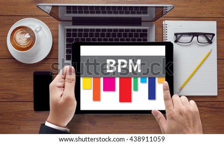 BPM - Business Process Management , on the tablet pc screen held by businessman hands - online, top view - stock photo