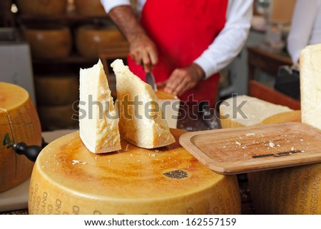 BRA - SEPTEMBER 22: Cut pieces of Parmesan - famous italian hard cheese made from raw cow's milk, often grated over dishes and named after producing areas near Parma, Italy on September 22, 2013. - stock photo