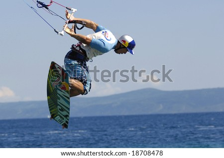 BRAC ISLAND, CROATIA MAY 23: An unidentified contestant participates in a KiteFlying contest at Zlatni Rat on Brac Island in Dalmatia, Croatia. The contest has taken place since 2008.