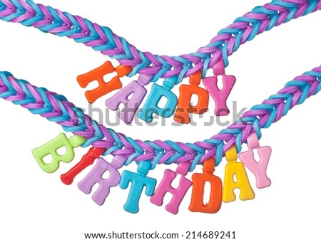 Bracelet formed using colorful rubber bands with the words HAPPY BIRTHDAY isolated on white background  - stock photo